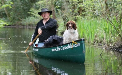 Man and dog canoeing