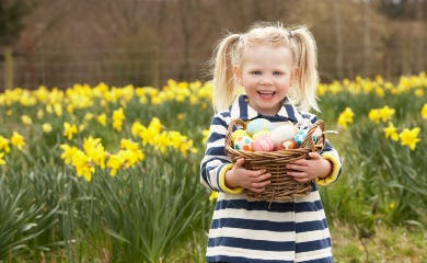 Girl holding Easter Eggs