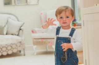 Little boy waving with a set of keys