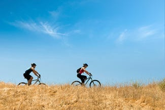 Two people cycling in the countryside