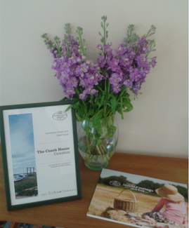 Winning property certificate in frame with flowers