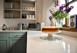 Victoria sponge in tidy kitchen