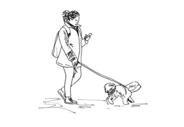 Girl walking her dog on a lead