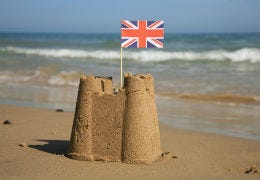 Union Jack flag in sandcastle
