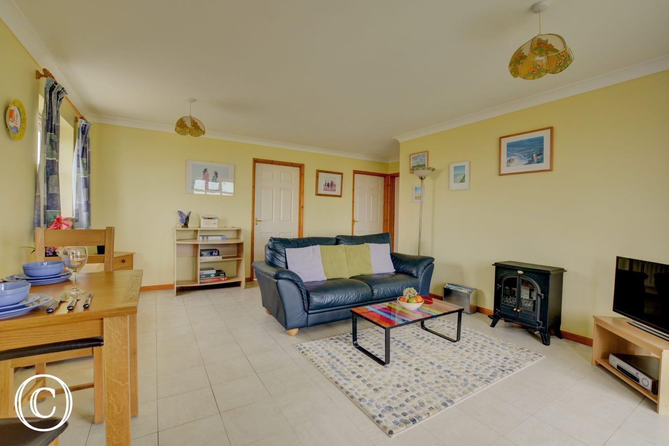 TV, video, woodburner-style electric fire, table and chairs, radio and CD player are all in the sitting room.