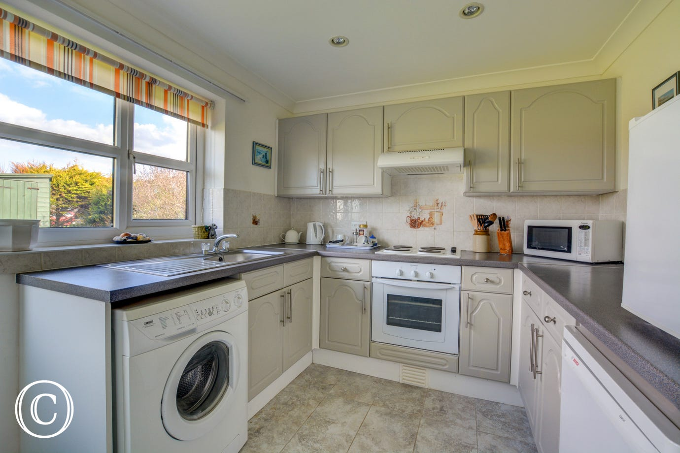 Kitchen with electric oven and hob