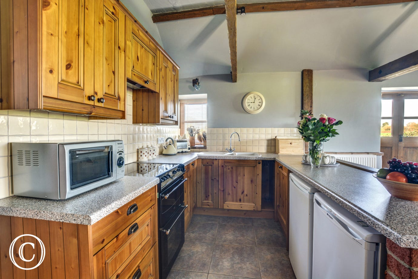 Traditional kitchen with most major appliances and well equipped with the added bonus of an utility room