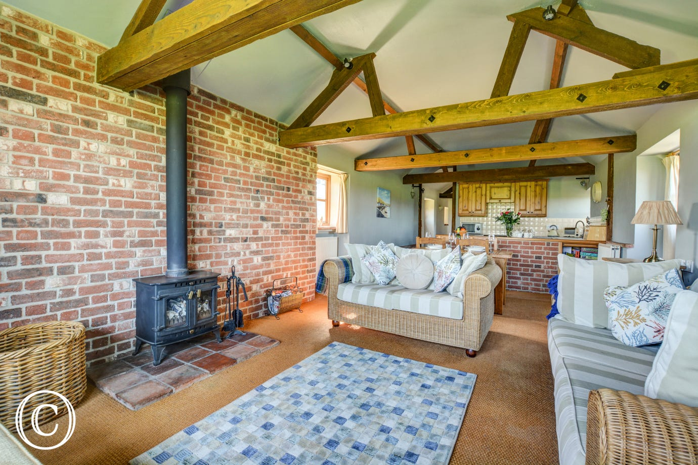 The sitting room has a traditional woodburner for those cosy evenings