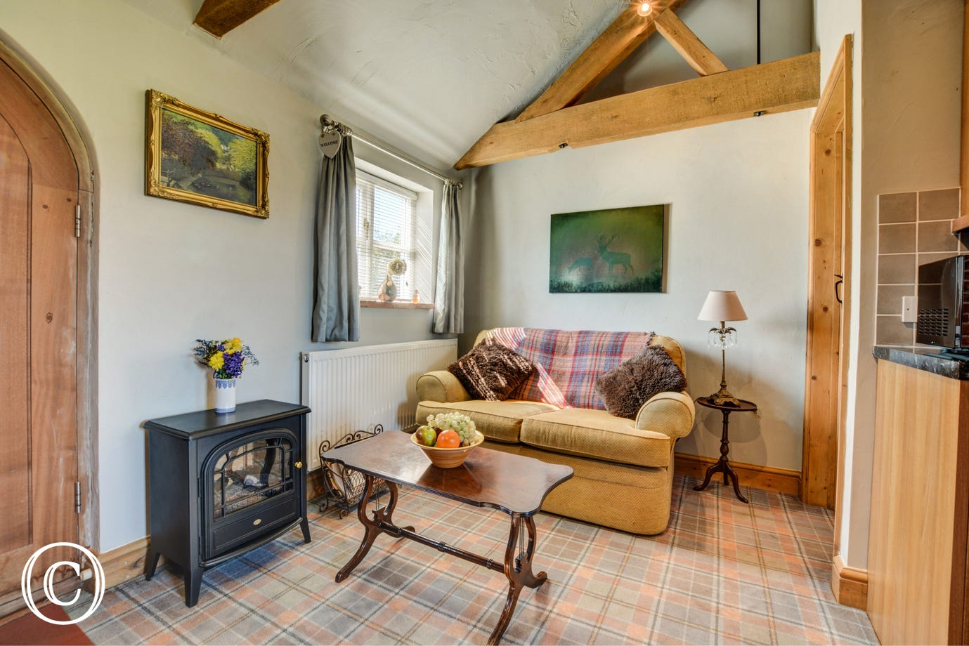 The sitting area has comfortable seating and an electric effect woodburner for cosy evenings