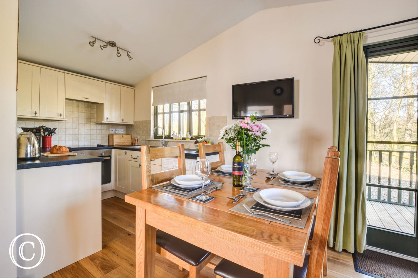 Light and airy dining area with a table and chairs, perfect for family meals