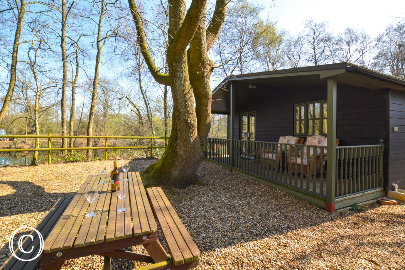 Porters Lodge is one of two detached lakeside lodges in a secluded fully enclosed setting comprising of a two acre lake surrounded by around three acres of tree-lined pathways/drive and picnic area.
