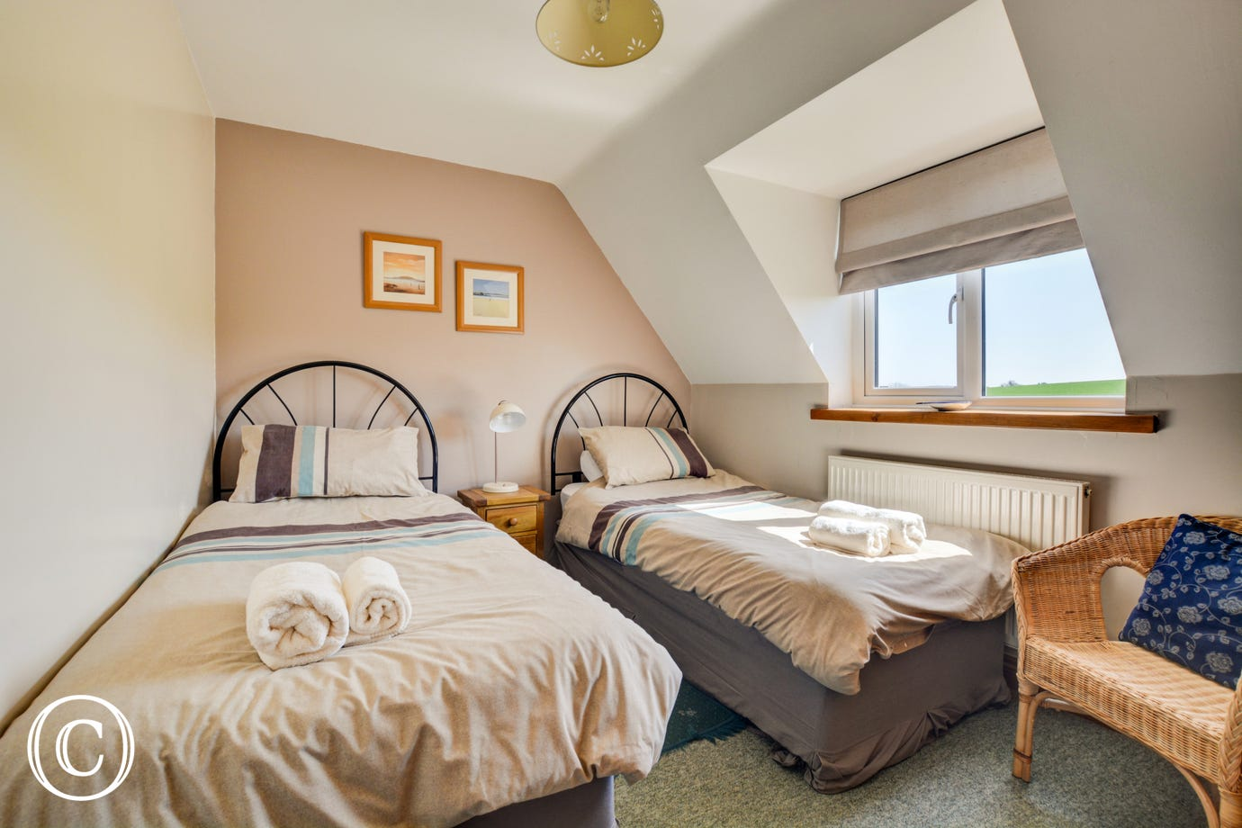 Cosy but light twin bedded room with seating