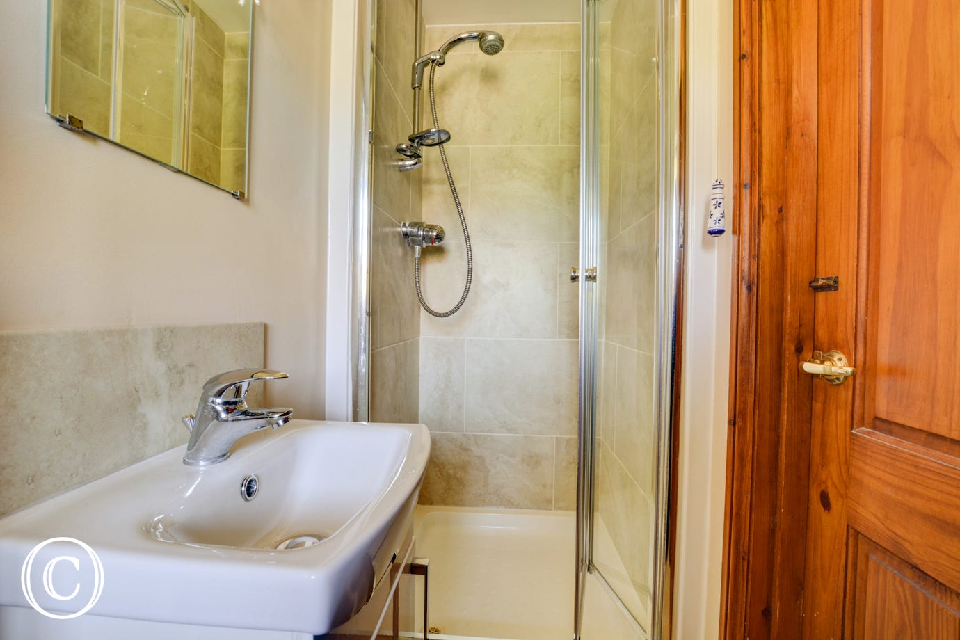 A separate downstairs shower room with handbasin and toilet.