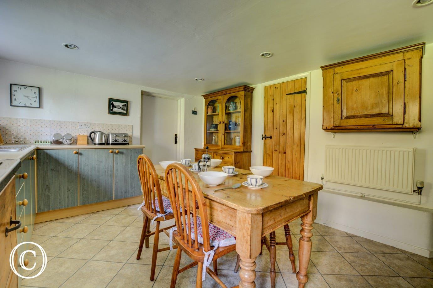 Kitchen showing table and chairs