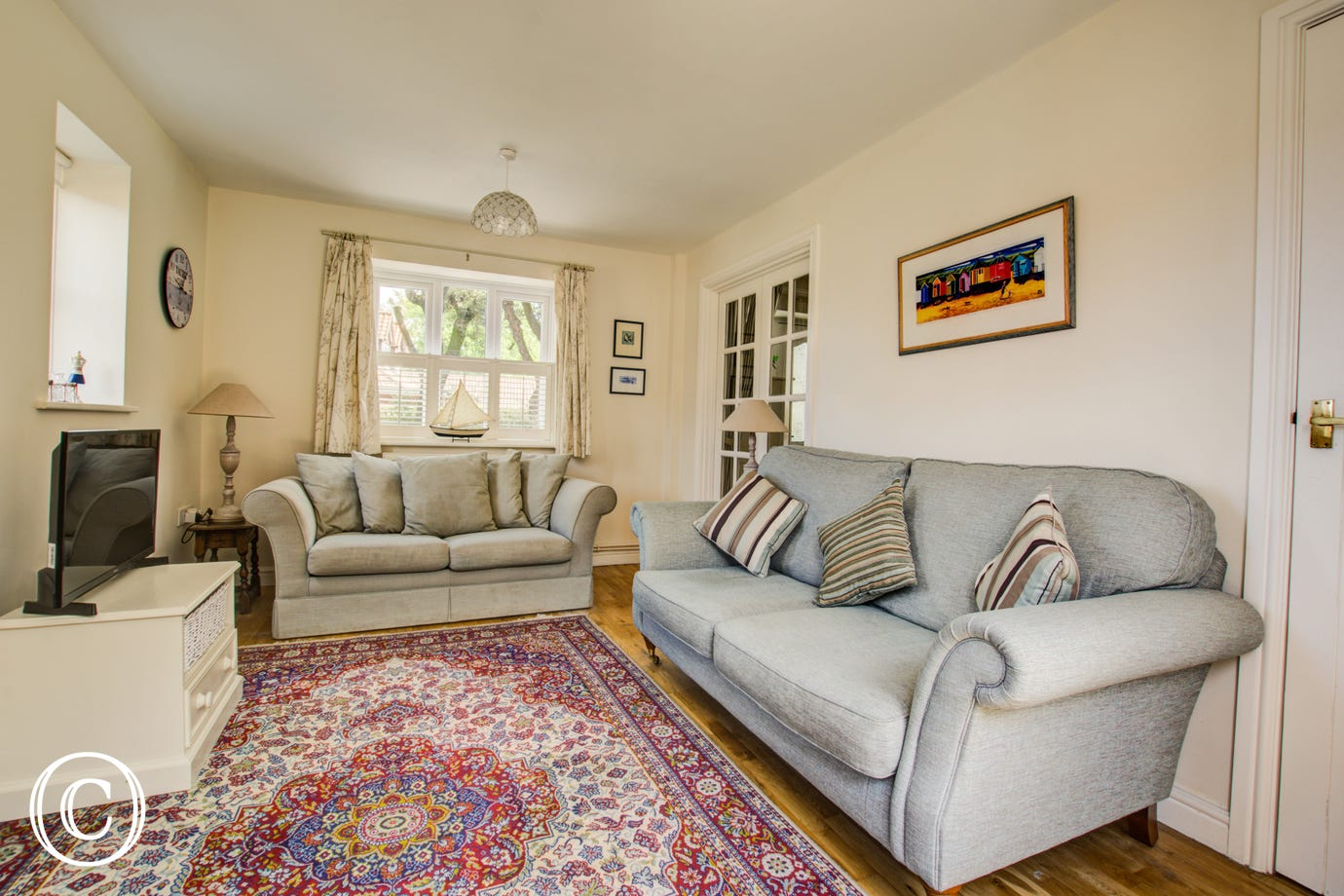 A cosy sitting room with two large sofas
