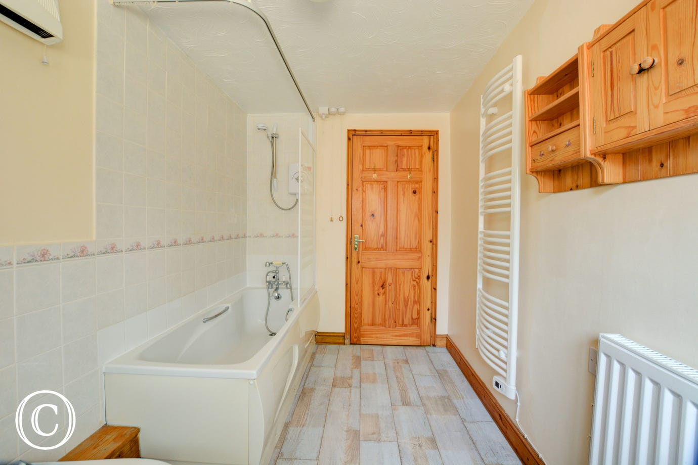 The Bathroom has a bath, over-bath electric shower, washbasin, bidet and wc