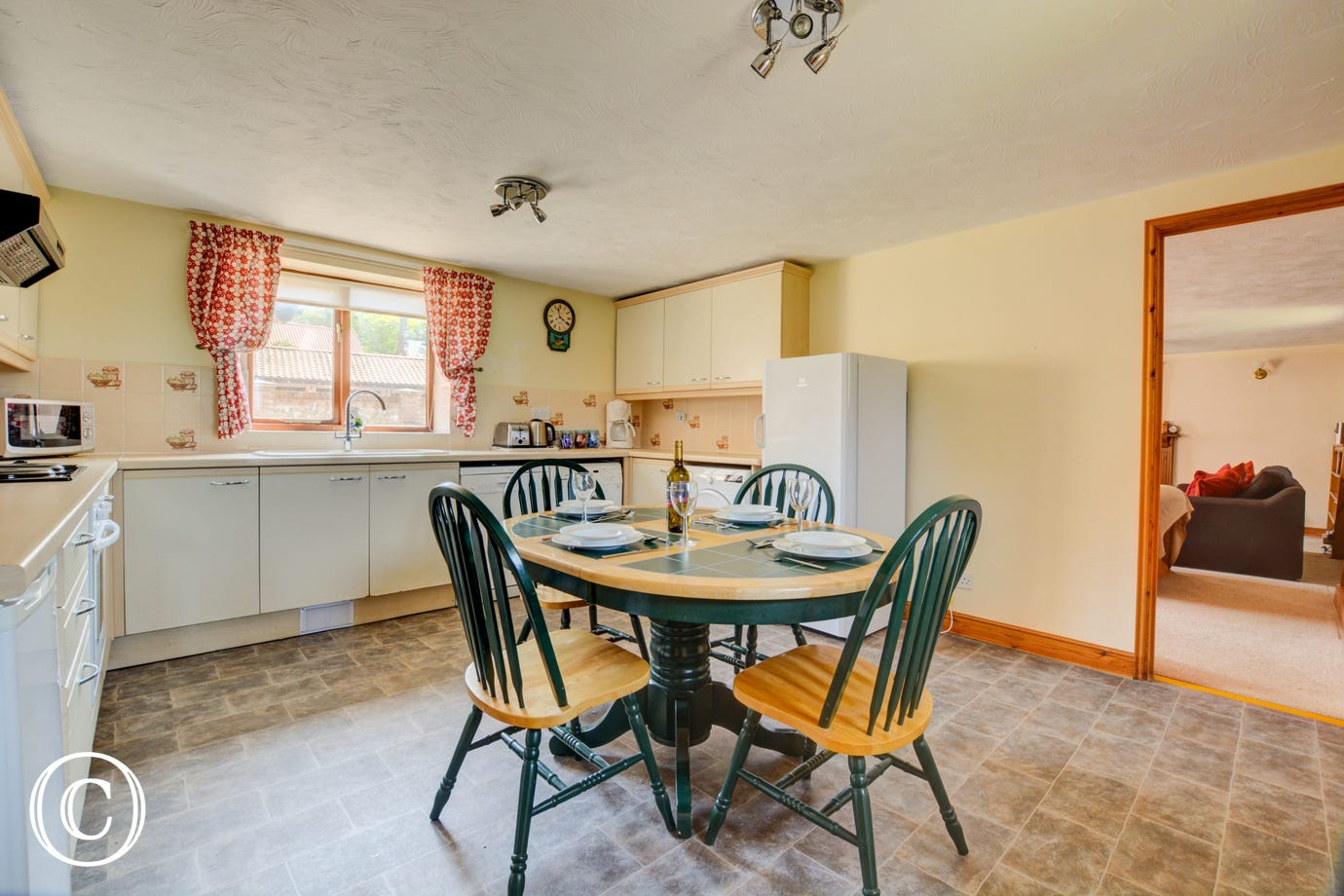 The spacious Kitchen/Dining Room has an electric cooker, dishwasher, washer/dryer, tumble dryer, combination microwave, fridge with icebox, bread-maker and coffee maker
