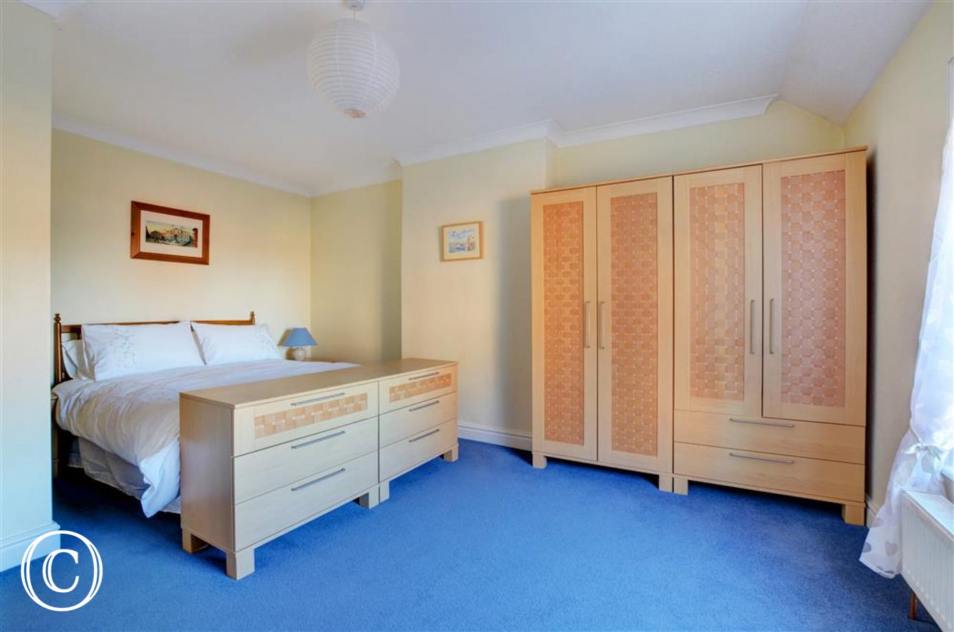 Spacious main bedroom with king sized bed