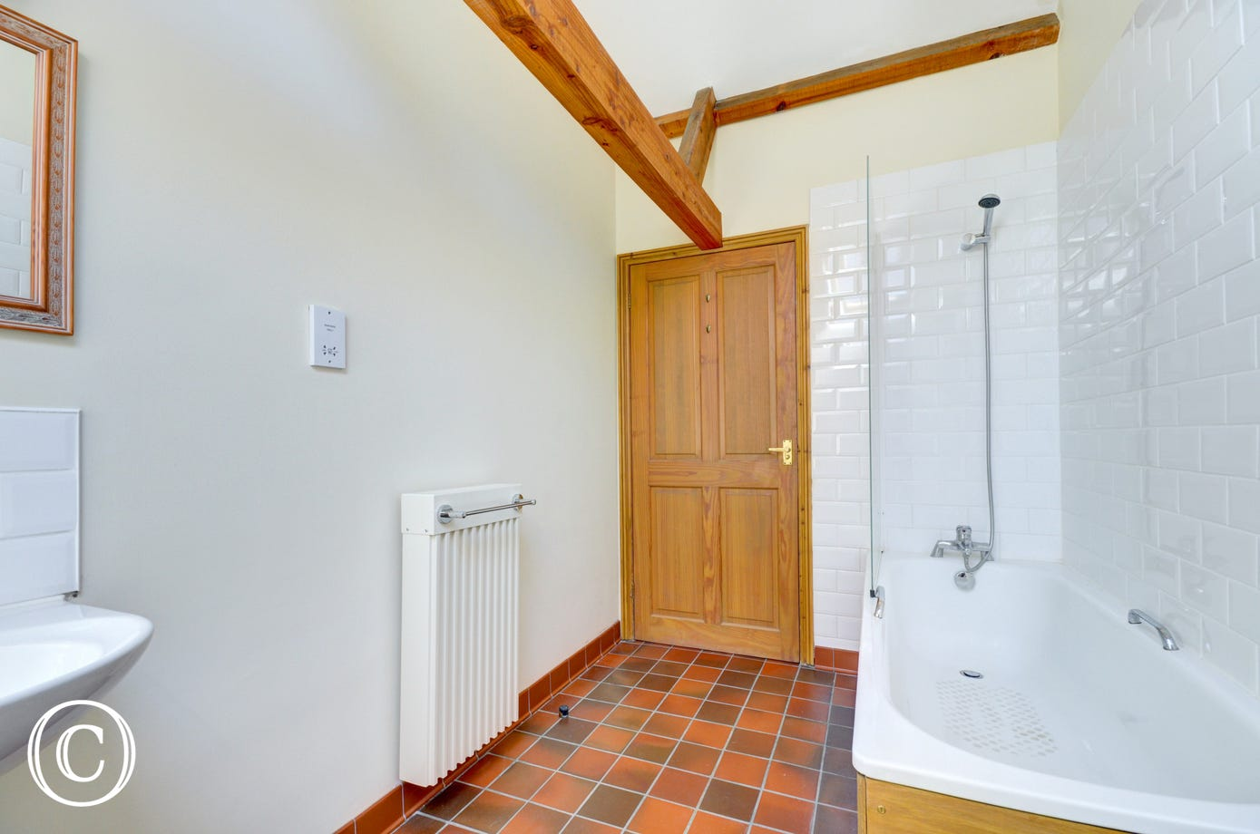 Bathroom with bath, over bath shower, basin and wc