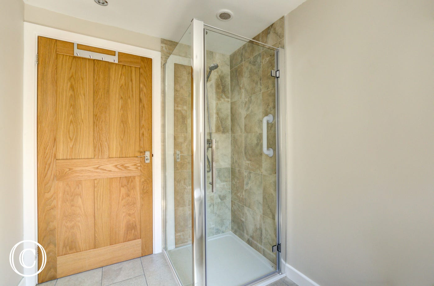 Bathroom showing shower cubicle