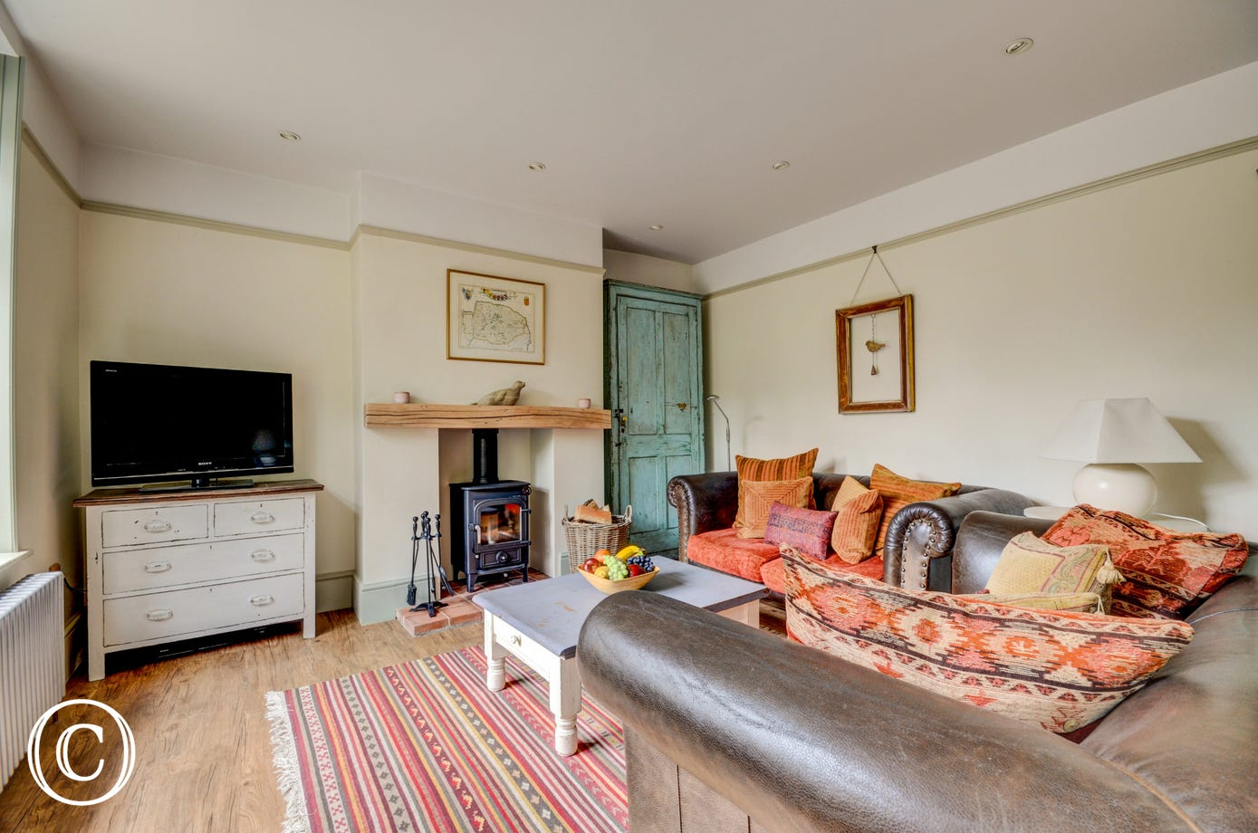 Sitting Room with comfortable seating, woodburner and TV