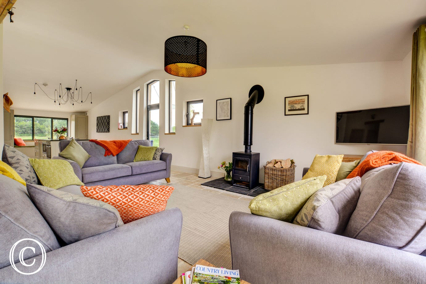 Sitting area with comfortable seating and woodburner