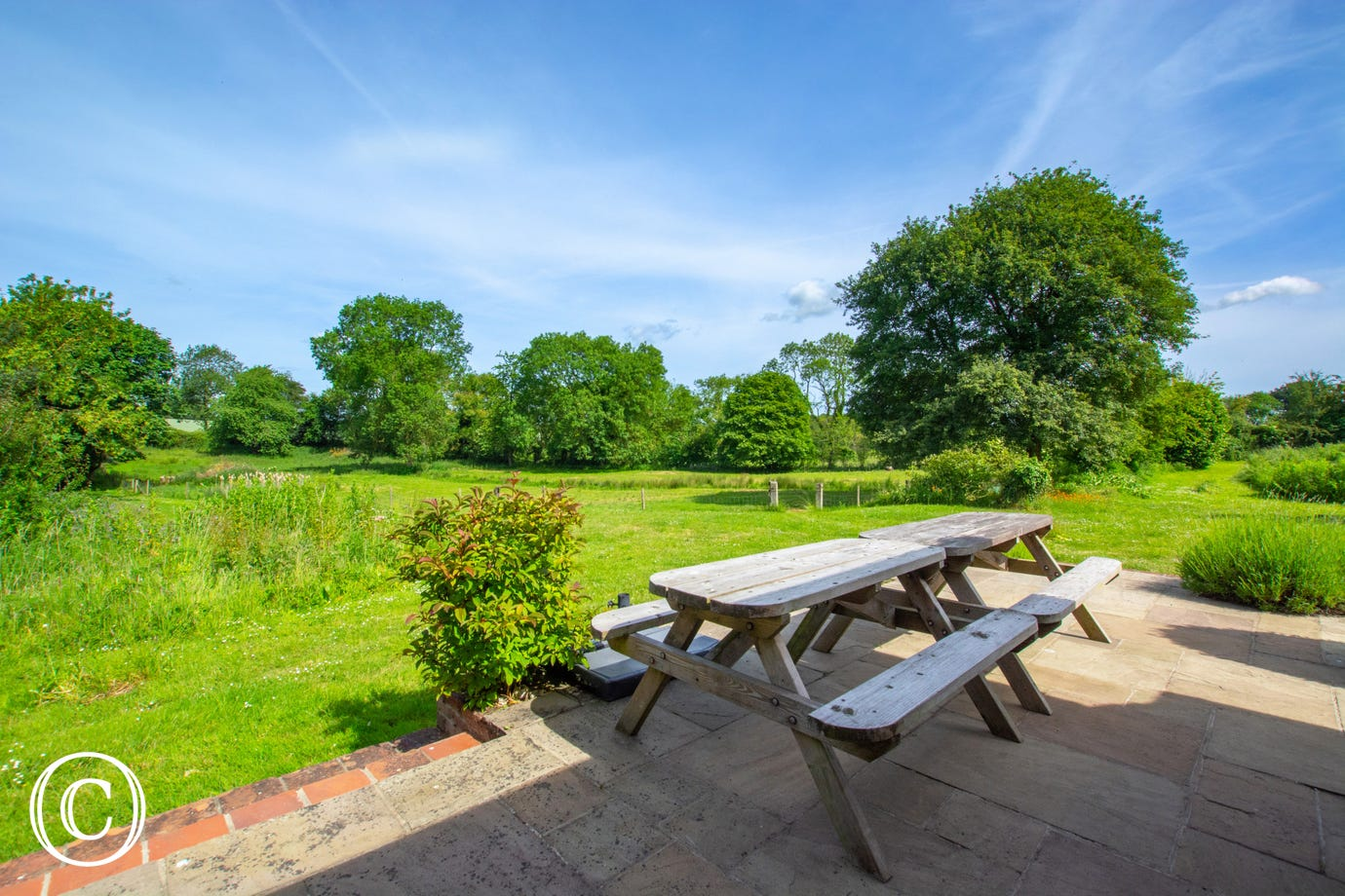 Patio and garden which comes complete with barbecue, garden log burner and table and chairs