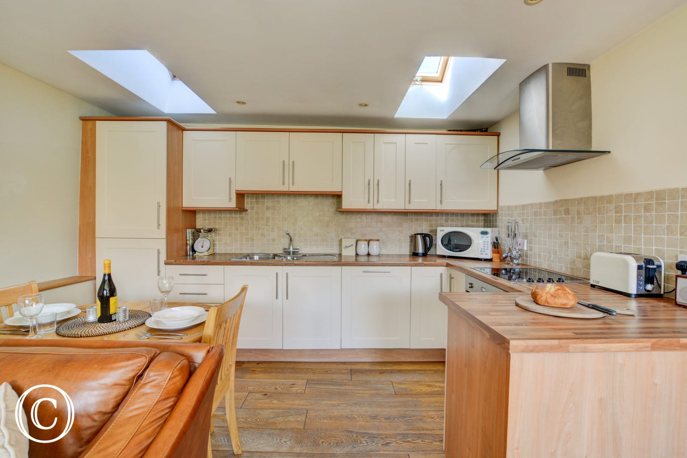 The kitchen area within the open plan living space is well equipped with everything you could need for a self catering holiday