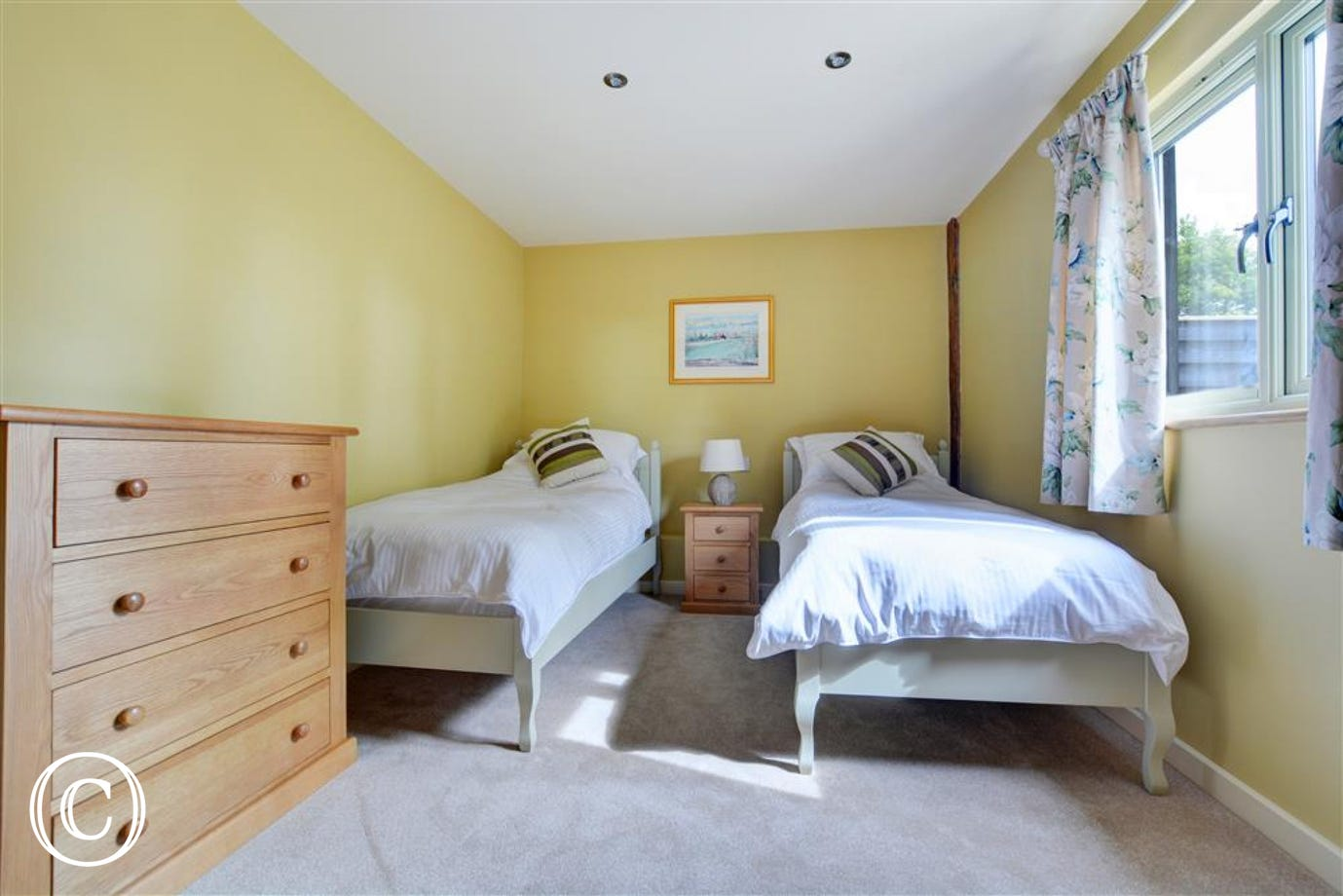 Bedroom two has two single beds