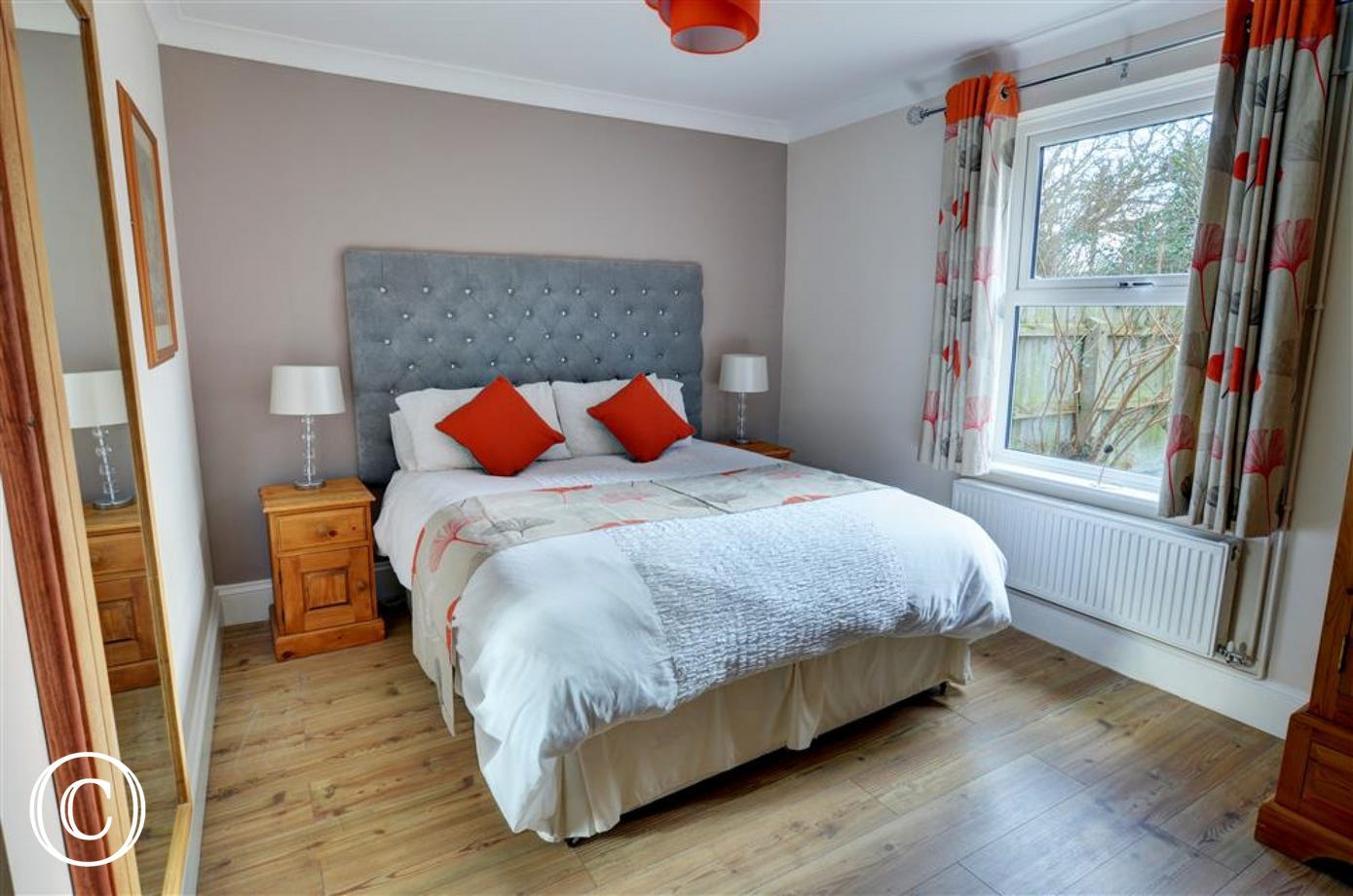 Main bedroom with a double bed