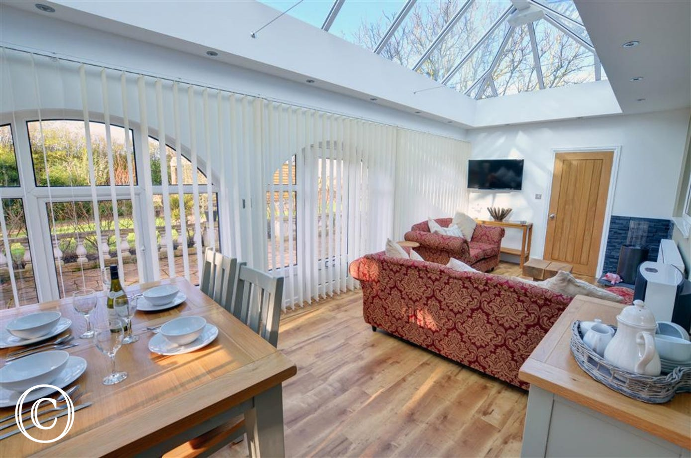 Beautiful conservatory with dining seating