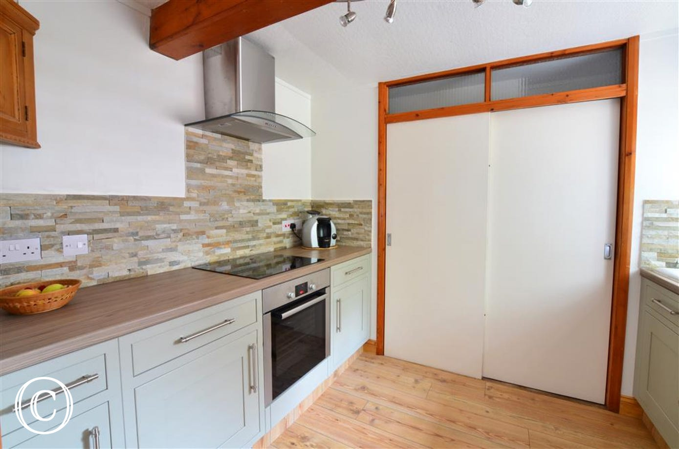 This lovely kitchen is modern, yet still retains original features