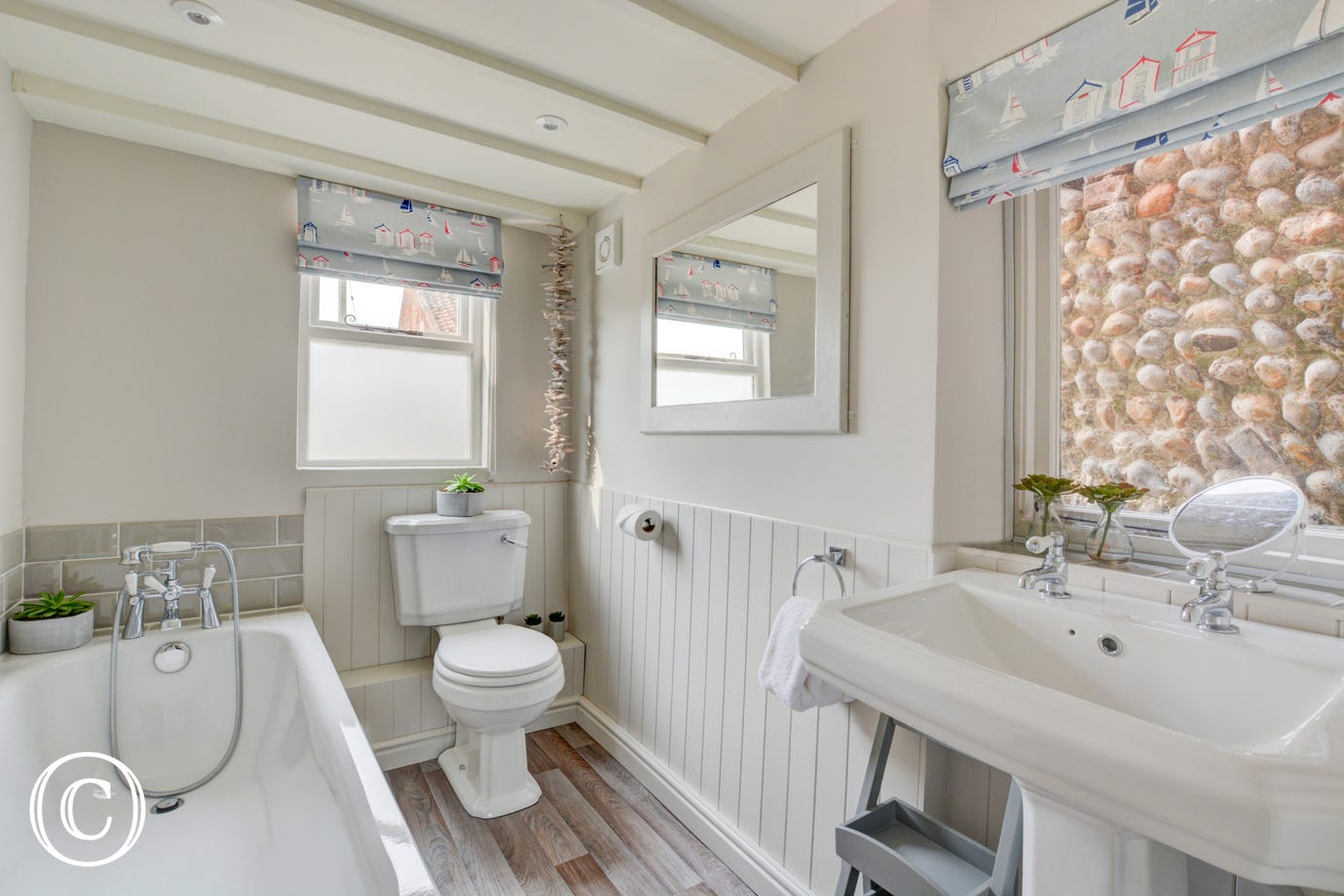 Bathroom with bath, hand held shower, washbasin and wc