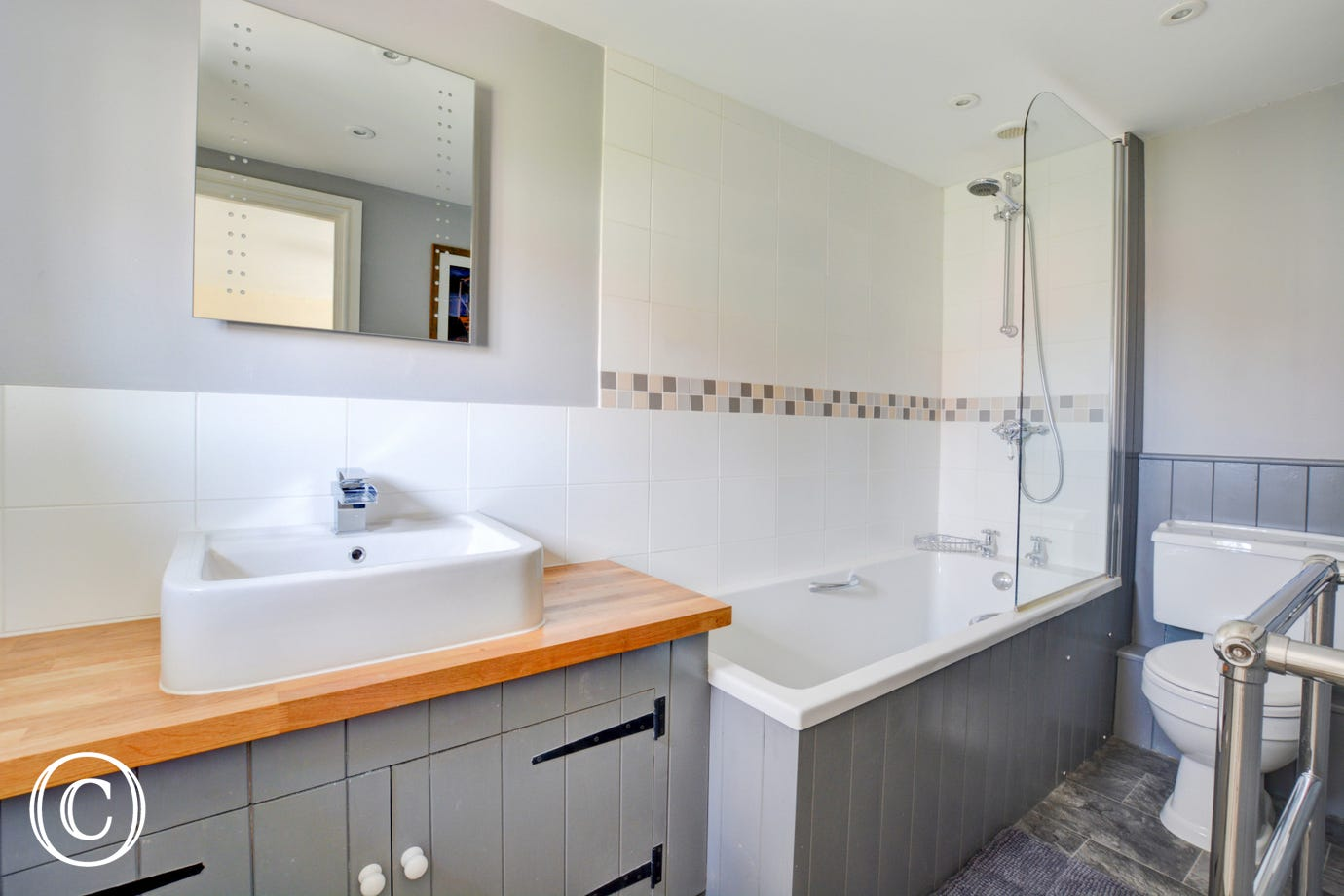 Bathroom with bath, over-bath shower, hand held shower, wash basin and wc
