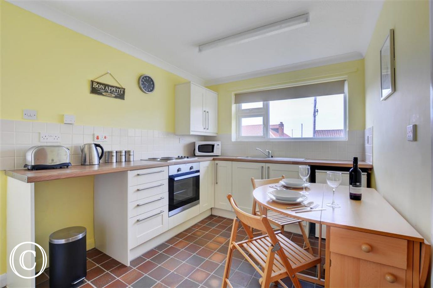 Well equipped kitchen with convenient dining area.