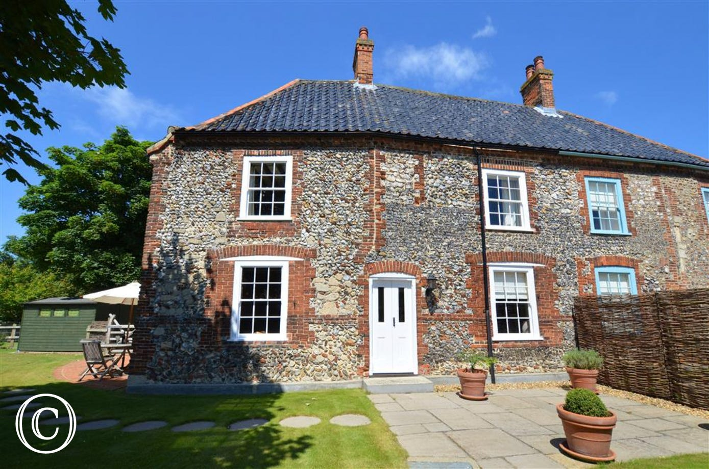 This is the rear of this attractive brick and flint property