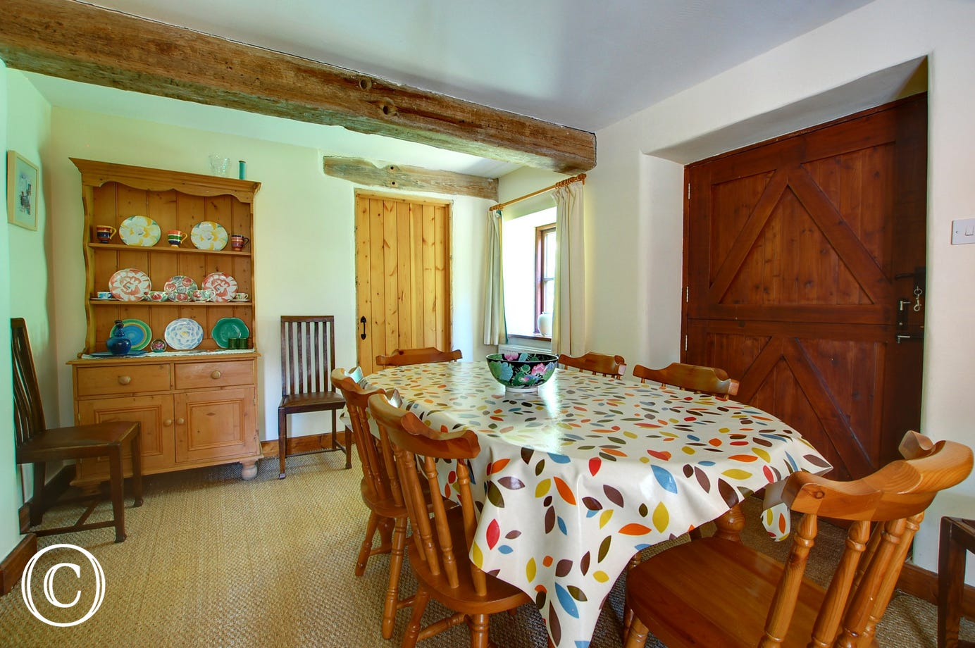 With a dining table, chairs and a pine dresser, perfect for family meals