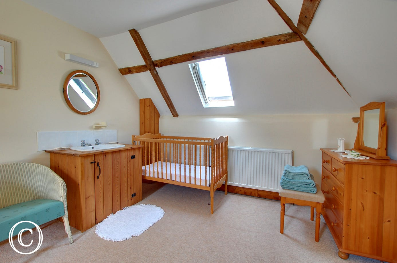 Spacious double room with a wash hand basin and room for a cot, ideal for a young family