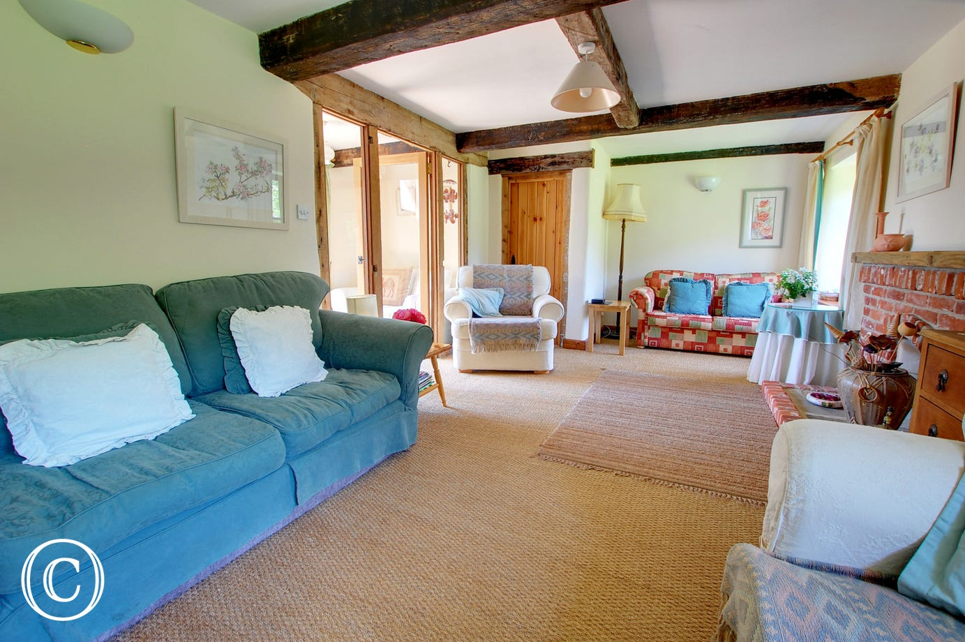 Attractively furnished with comfortable seating and full of original features, a lovely family space