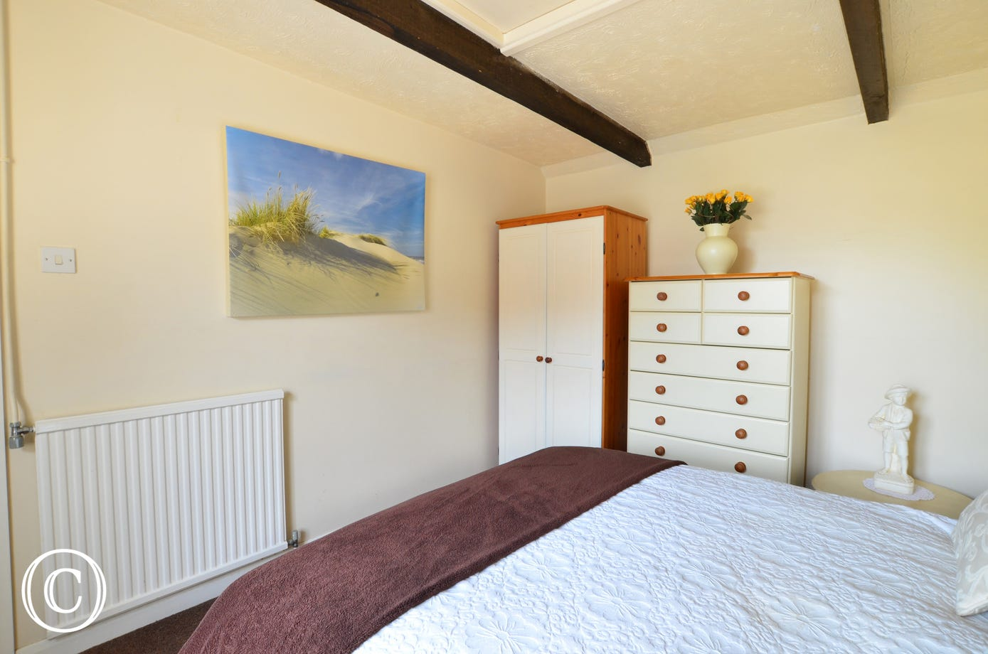 Double bedroom with double bed, chest of drawers and a wardrobe