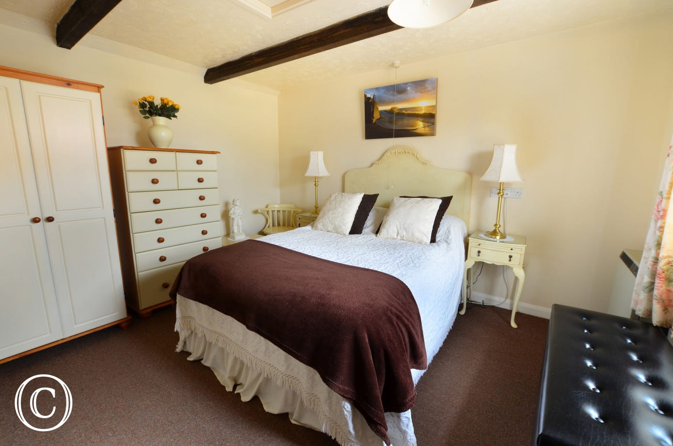 Pretty double bedroom with a double bed and original beams