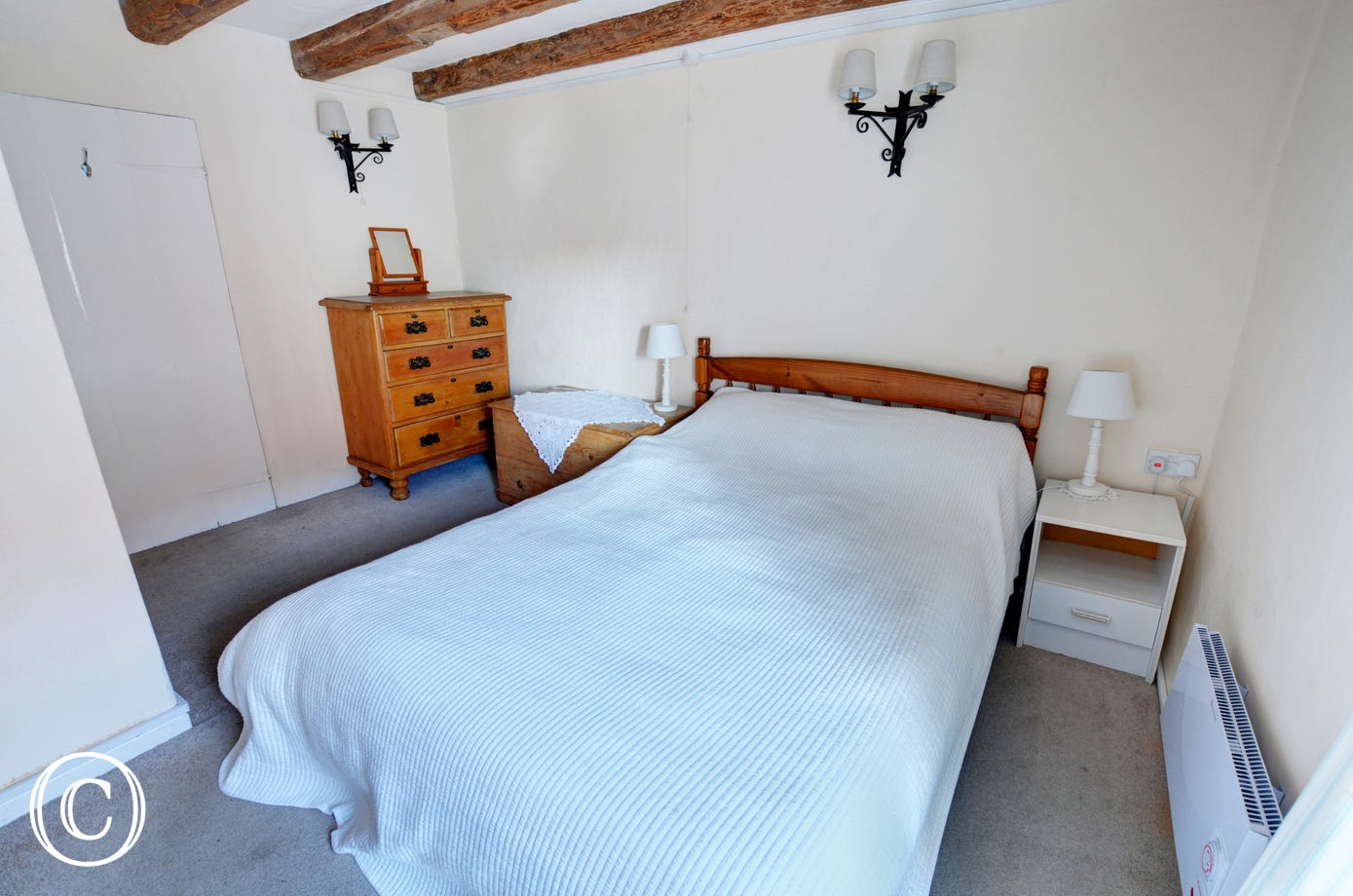 Charming first floor double bedroom with a double bed and exposed beams