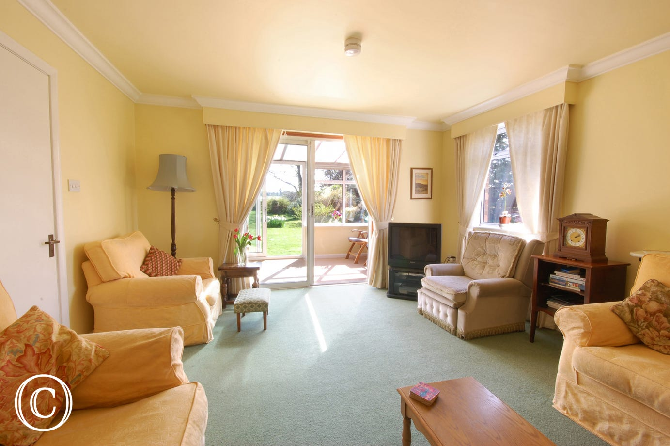 Light, comfortable and spacious sitting room with views of the garden and beyond.