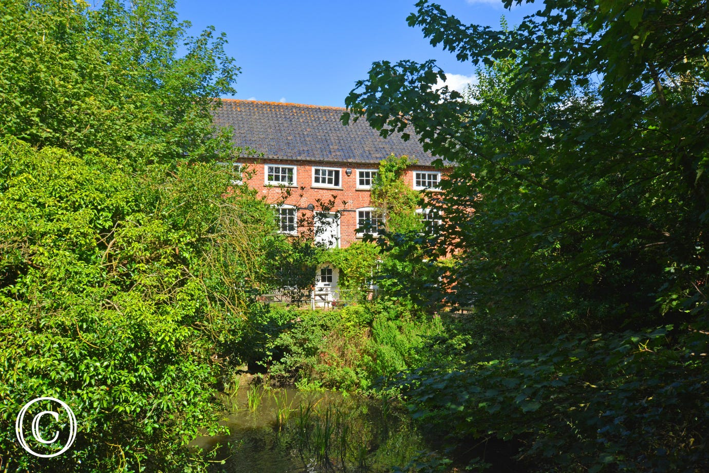 Quietly situated in an idyllic rural position one mile from the town centre, this 200-year-old mill faces south and is located directly over the mill stream, offering glorious views of the surrounding countryside.