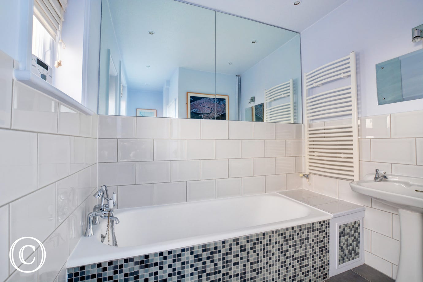 A contemporary bathroom with mosaic tiling.