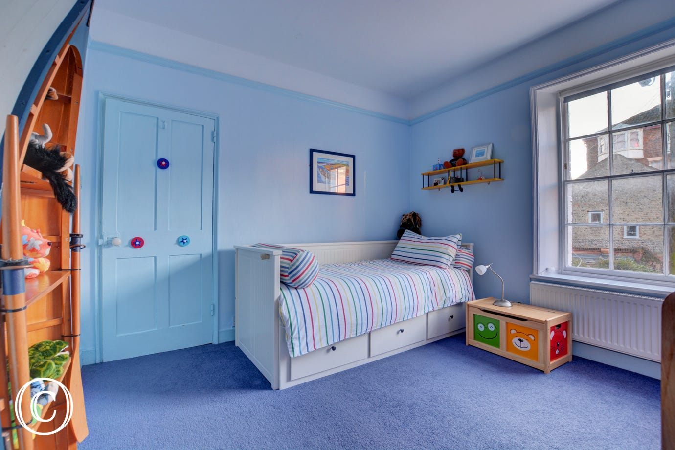 A single bedded room with a seaside theme.