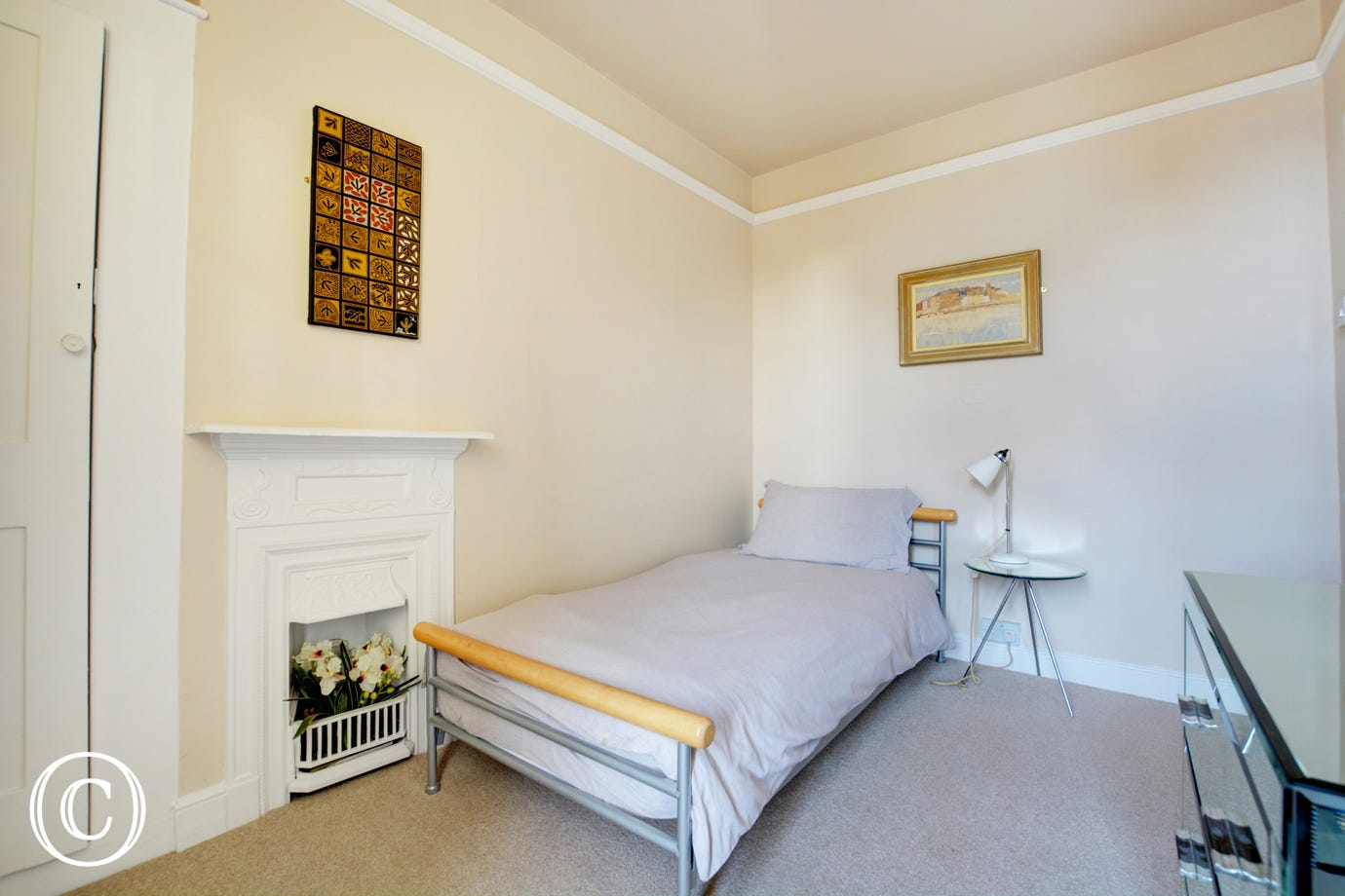 A single bedded room with feature fireplace and stylish fittings.