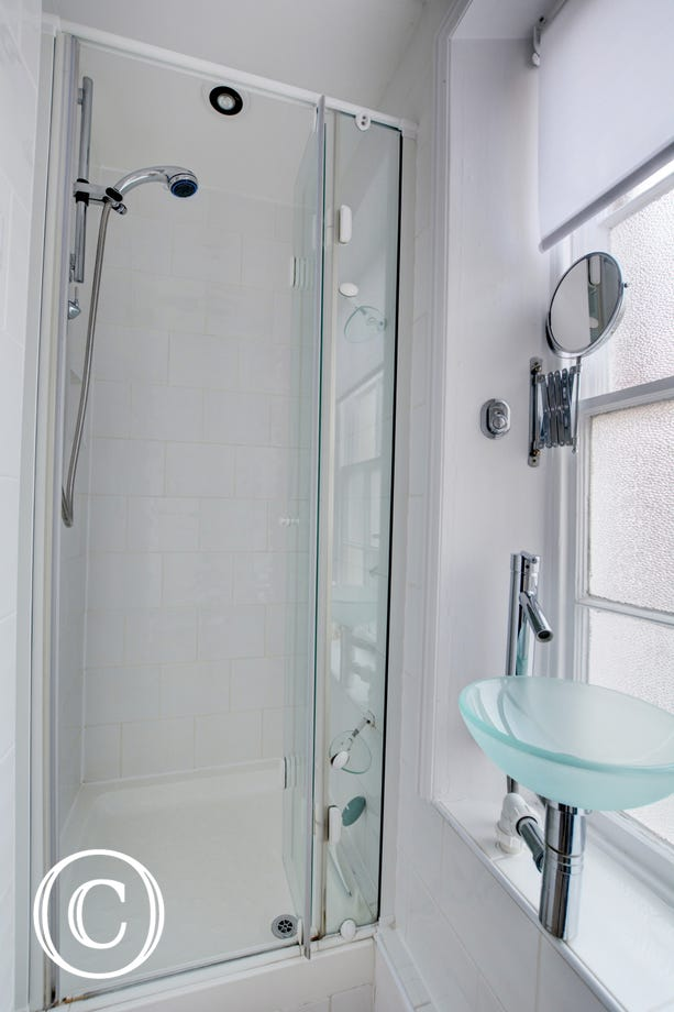 A shower cubicle with bi-folding doors.