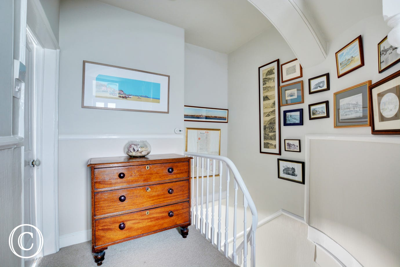 A curved wall to the top of the stairs and landing area, lovely feature