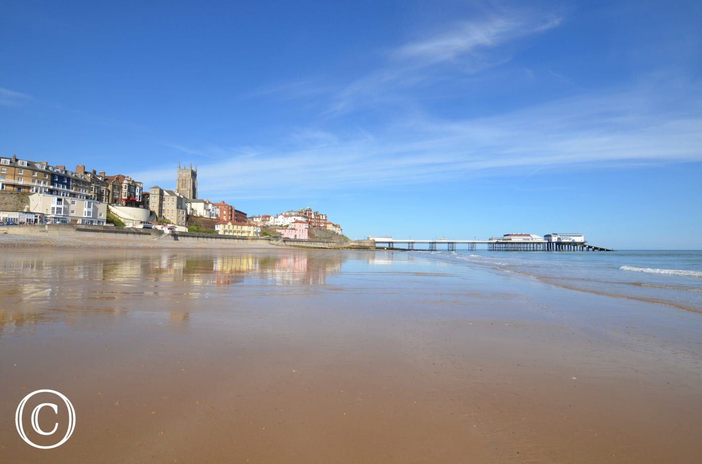 A stunning view of Cromer Beach with the Pier in the distance.